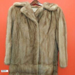 Mink dinner coat.